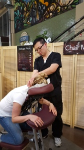 Brian gives a relaxing chair massage at our Lincoln Park Location